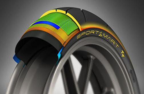 En la imagen una rueda de moto seccionada para que se aprecien sus diferentes capas y compuestos